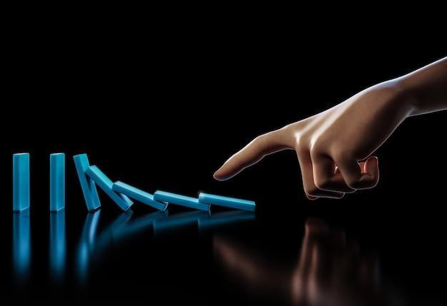 3d рендеринг человеческая рука толчок синего домино разбивается в движении Premium Фотографии