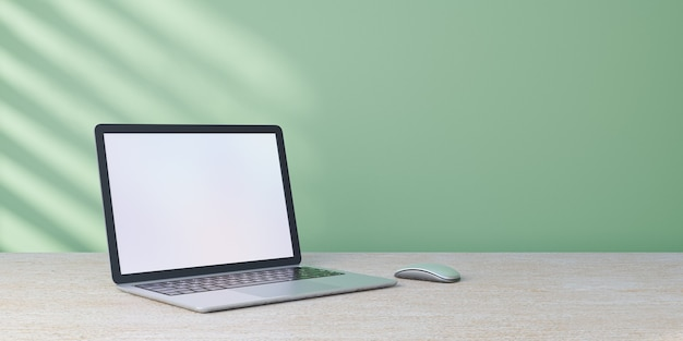 3d rendering object. laptop computer mouse placed on wood desk and pastel green wall with sun light.