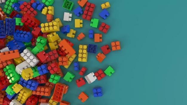 3d-рендеринг связки красочных игрушечных пластиковых кирпичей для детей на зеленом фоне