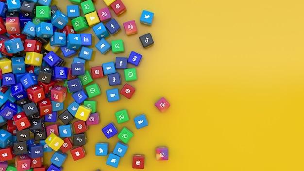 黄色の背景の上にメインのソーシャルネットワークアプリのロゴが付いたマルチカラーキューブの束の3dレンダリング