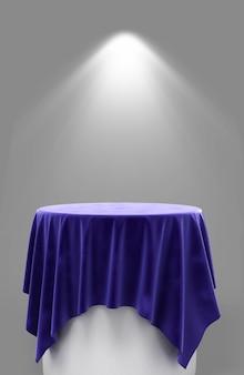 照明付きの灰色の背景の丸い台座に青いベロア布の3dレンダリング