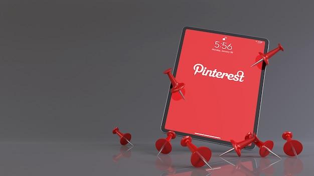 3d-рендеринг красных булавок перед ipad с логотипом приложения pinterest.