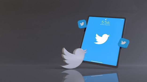 앱 로고가 표시된 태블릿 앞에 있는 twitter 로고의 3d 렌더링.