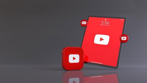 3d-рендеринг логотипа youtube перед планшетом, на котором отображается логотип приложения.