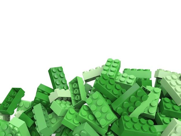 복사 공간이 많은 녹색 그늘에서 장난감 건물 벽돌의 3d 렌더링