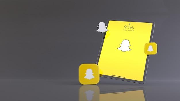 Трехмерный рендеринг двух четырех значков snapchat и логотипа перед планшетом, на котором отображается логотип приложения snapchat.