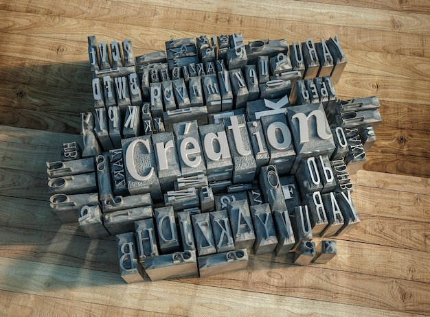 3d rendering of printing press metallic letters forming the word creation