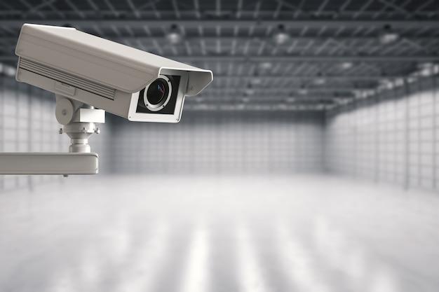 3d-рендеринг камеры безопасности или камеры видеонаблюдения на пустой фабрике