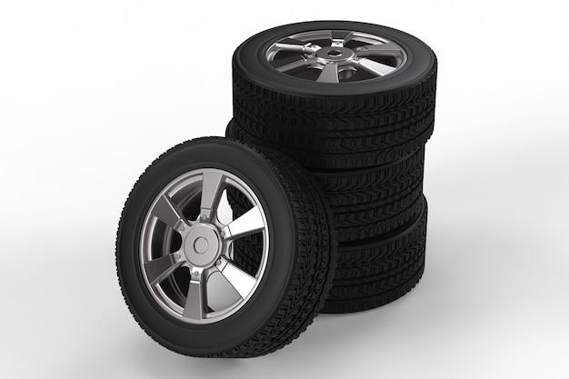 白い背景の上の合金ホイールと黒いタイヤの3dレンダリングスタック
