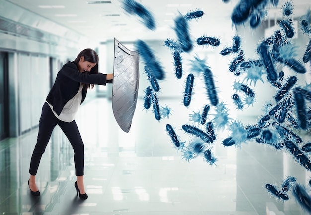3dレンダリング。女性はバクテリアの攻撃によって盾で保護します