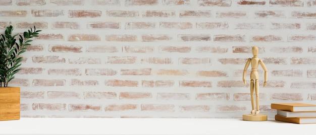 Рабочее пространство 3d-рендеринга с книгами, копией пространства деревянной фигуры и горшком на белом столе с кирпичной стеной