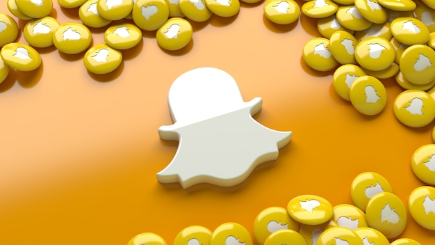 3d логотип snapchat на оранжевом фоне в окружении множества глянцевых таблеток snapchat
