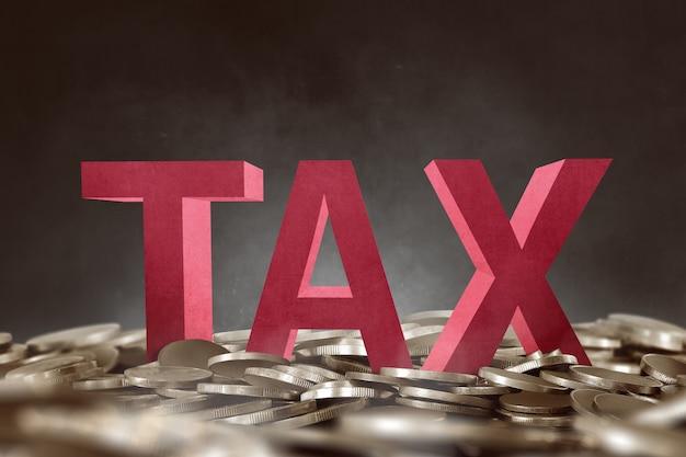3d tax text on golden coin pile