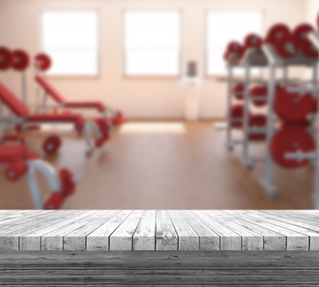 3d white wooden table looking out to a defocussed gym interior