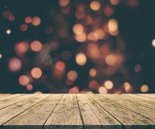 ボケライトを背景に古い木造のテーブルとクリスマスの背景のレンダリング3d