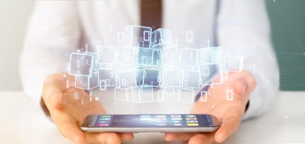 Бизнесмен держит облако блокчейн куба и двоичных данных 3d-рендеринга
