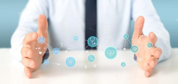 Бизнесмен держа медицинский перевод значка и соединения 3d