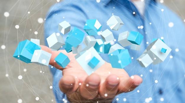 Бизнесмен держит летающий синий блестящий куб 3d-рендеринг