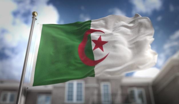 ブルースカイの建物の背景にアルジェリアの旗の3dレンダリング