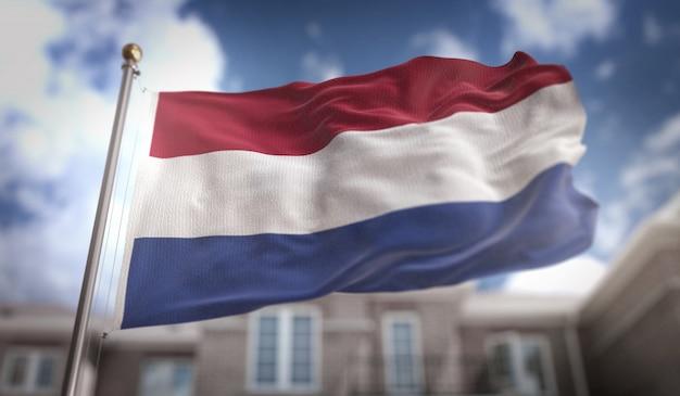 オランダのフラグ3dレンダリングの青空の建物の背景