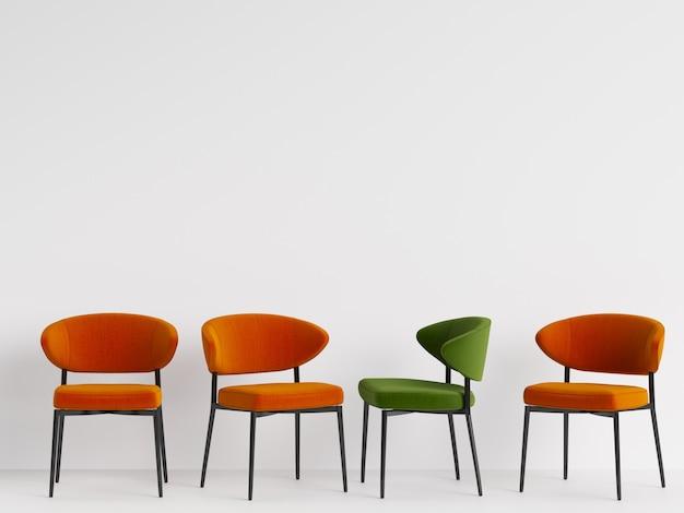 Зеленый стул среди оранжевых стульев на белой стене. понятие минимализма. 3d-рендеринг
