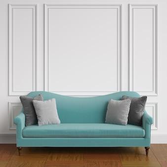 古典的なインテリアに立っている灰色の枕と古典的な青いソファ。成形品、床の寄せ木張りの白い壁。 3dレンダリング
