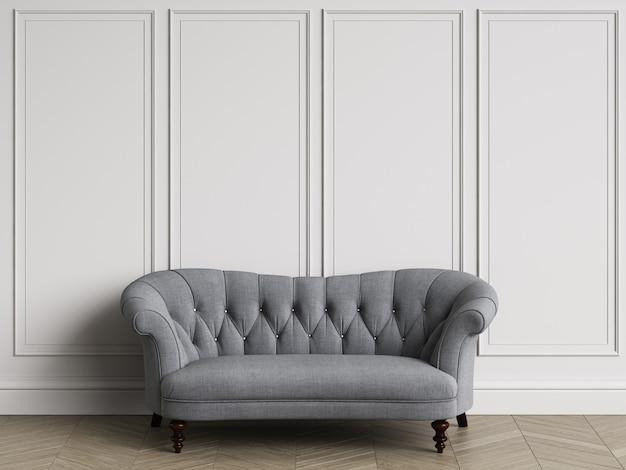 コピースペースのあるクラシックなインテリアのクラシックな房状ソファ。モールディングのある白い壁。床の寄木細工のヘリンボーン。 3dレンダリング