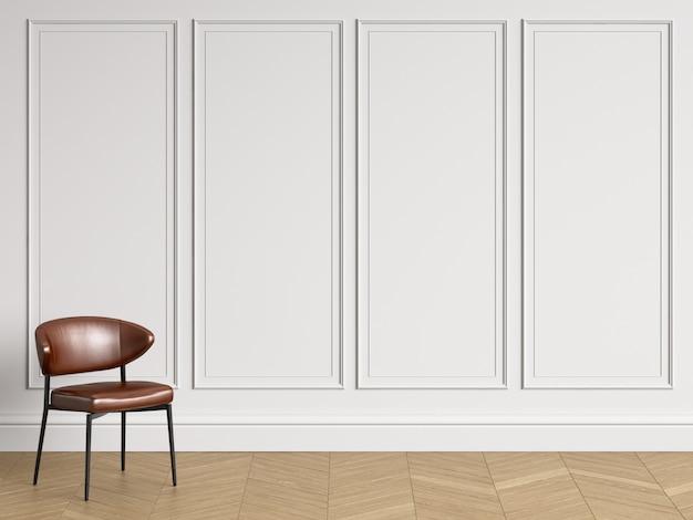 コピースペースを持つ古典的なインテリアの椅子。モールディングのある白い壁。床の寄木細工のヘリンボーン。 3dレンダリング