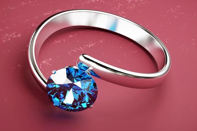 Голубое круглое кольцо с бриллиантом помещенное на пинке, переводе 3d.