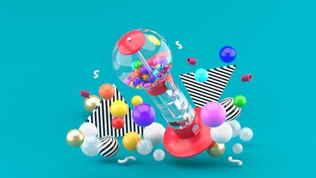 Машина шарика камеди среди красочных шариков на сини. 3d-рендеринг.
