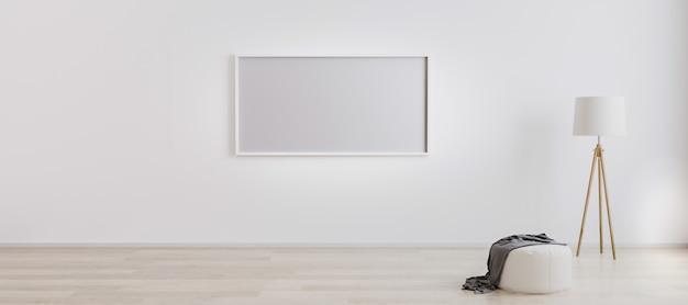 Интерьер светлой комнаты с горизонтальной пустой рамкой для макета с деревянным торшером, белым пуфом и деревянным полом с белой стеной. фоторамка на белой стене. белый яркий настенный макет. 3d-рендеринг