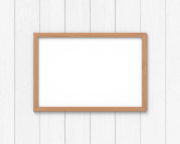 壁に掛かっている水平方向の木製フレームモックアップ。画像またはテキストの空のベース。 3dレンダリング。
