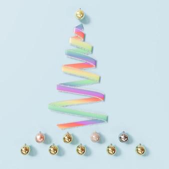 レインボーリボンクリスマスの日の装飾オブジェクトは、青のクリスマスツリーで形します。最小限のアイデア。 3dレンダリング。