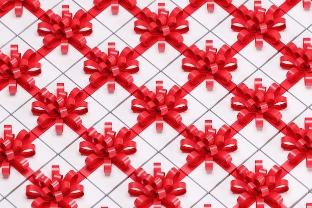 赤いリボンと白いギフトボックスを閉じます。 3dレンダリング。クリスマスのアイデアコンセプト。