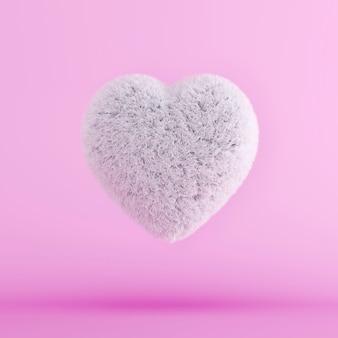 白い毛皮の心が浮かんでいます。最小限のバレンタインコンセプト。 3dレンダリング