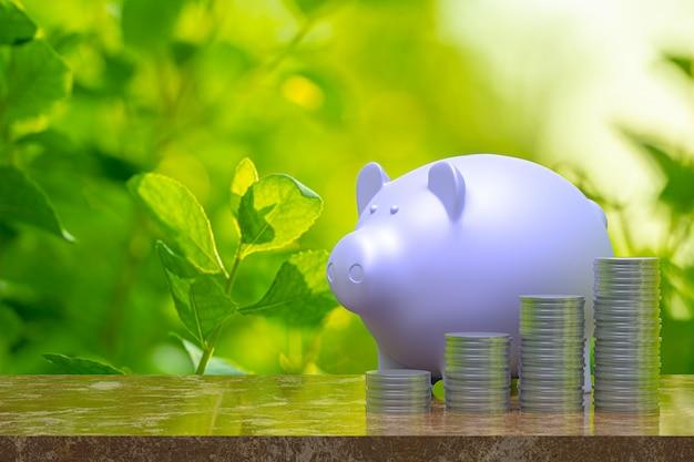 3dレンダリング、貯金箱とコイン、ビジネスと金融の概念のアイデアのために育った節約