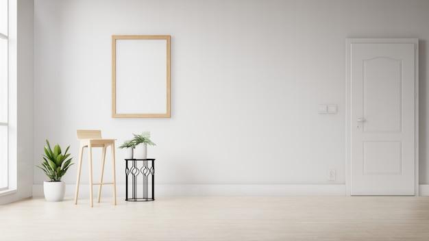 白い壁に掛かっているインテリアの空白のフォトフレーム。 3dレンダリング。
