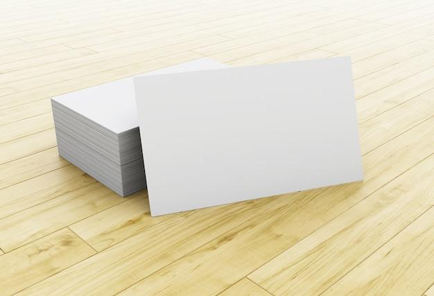 3d木製のテーブル上の空の名刺のスタック