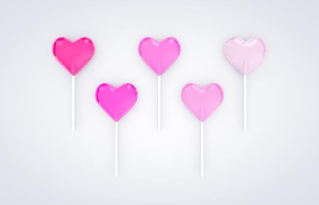 3dレンダリング白い背景と分離の甘いバレンタインハート型ロリポップキャンディー。