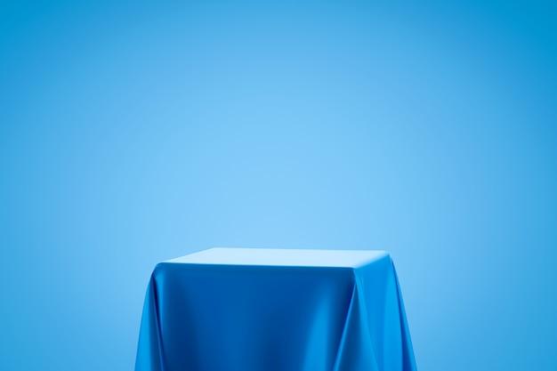表彰台の棚または空のスタジオの青い布地は、アートスタイルの明るい青のグラデーション壁に表示されます。製品を表示するための空白のスタンド。 3dレンダリング。