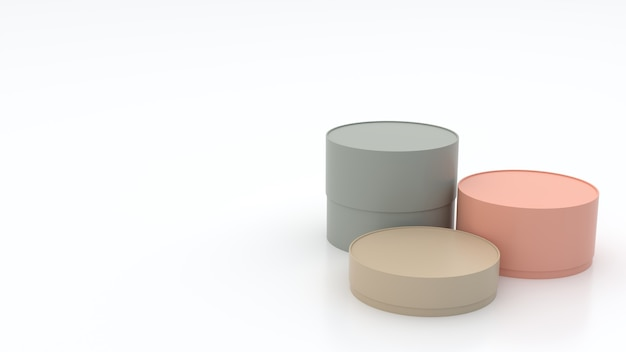 다양한 크기의 세 번째 원통형 상자, 바닥에 파스텔 색상 및 흰색