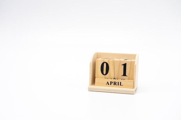 ビンテージウッドの抽象的な背景に4月1日の木製カレンダー。エイプリルフール