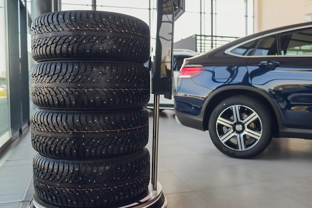 4 new tires that change tires in the auto repair service center, blurred background
