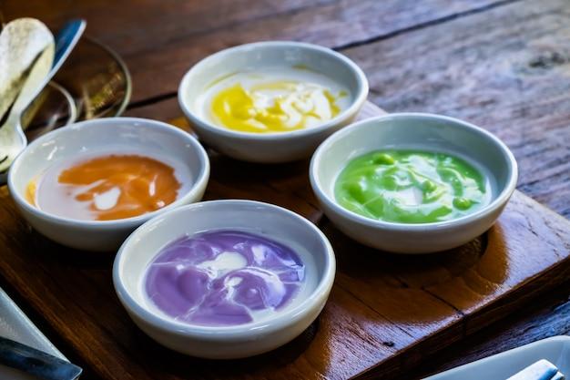 The 4 thai style custard dip in the white dish