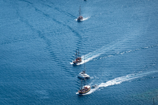 4 of yacht sailing on opened sea.
