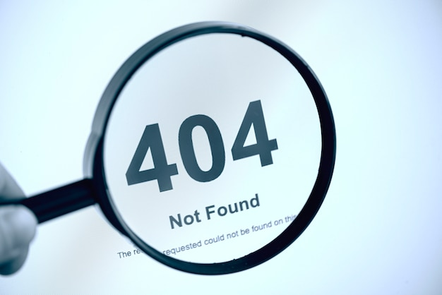 404 error internet page not found, hand with magnifier, concept picture