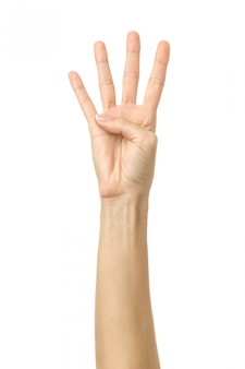 ナンバー4。白で隔離される女性の手ジェスチャー