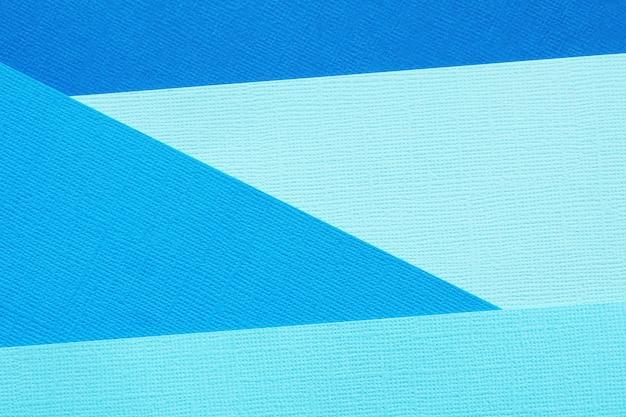 抽象的な背景と異なる色合いの4つの青い紙のテクスチャ。