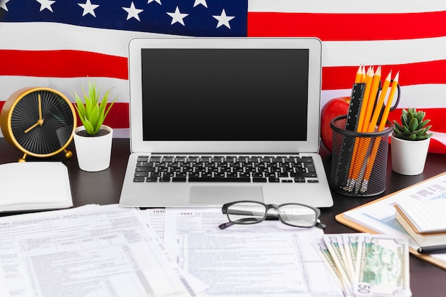 4th of july american independence day usa flags decorations in office desk with computer