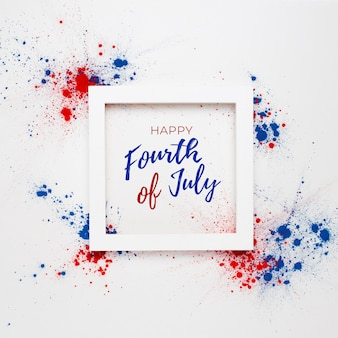 4th of july background with lettering in a frame and fireworks made with splashes of holi color